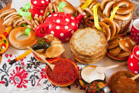 pancake week: Pancake with red caviar and tea during  Pancake Week