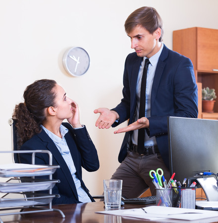 lecturing: Stressed boss scolding employee for work mistakes indoors Stock Photo