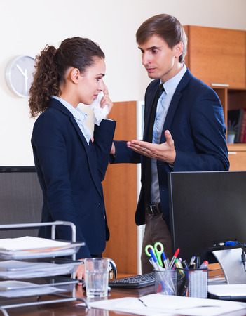 subordinate: Dissatisfied manager arguing with unhappy young subordinate official in office Stock Photo
