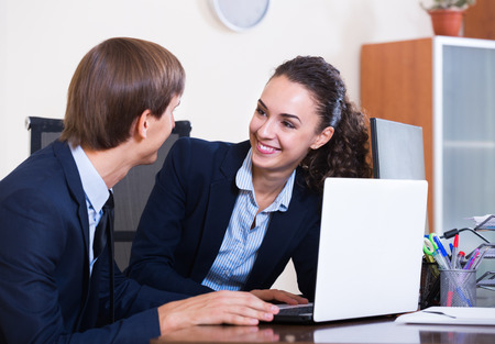 yuppie: White-collar work:  happy woman and man in modern office