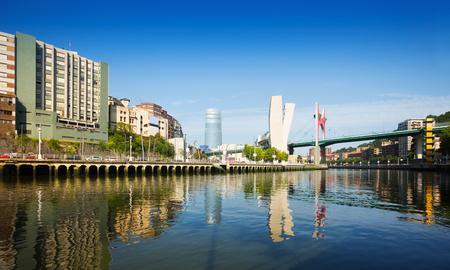 salve: View of Bilbao. Embankment of   Nervion river and La Salve Bridge  in sunny day.   Spain