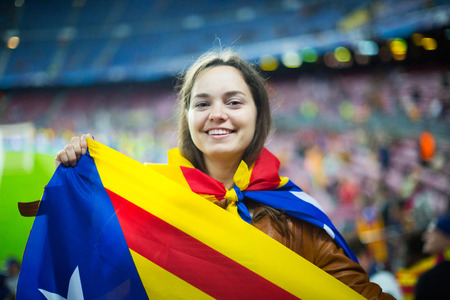 rooting: Excited young girl with Catalonia flag rooting for football team