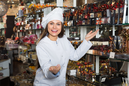 shopgirl: shopgirl posing with delicious chocolate and confectionery at display