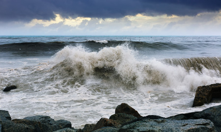 mediterranea: Sea wave near stones coast in cloudy day Stock Photo