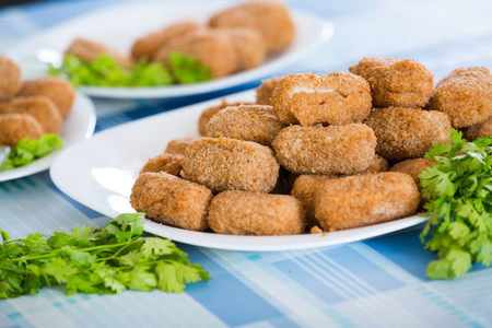 crocchette: Popular side dish Croquetas fritas on plates Stock Photo