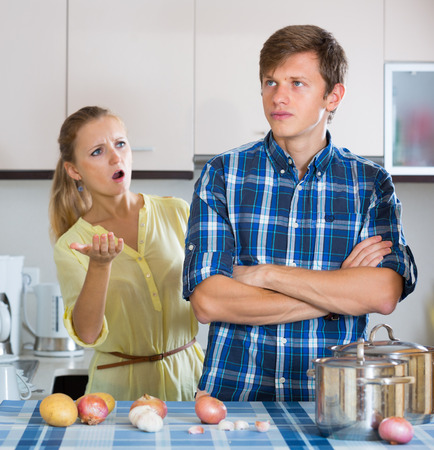 25 35: Upset man and frustrated housewife having bad argument indoors