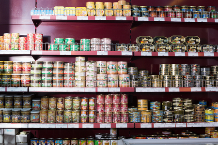 tinned: BARCELONA, SPAIN - FEBRUARY 02, 2016: Shelves with ordinary assortment of tinned and canned products in East European food store