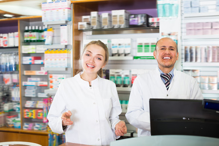 farmacy: Portrait of two pharmacists working in modern farmacy Stock Photo