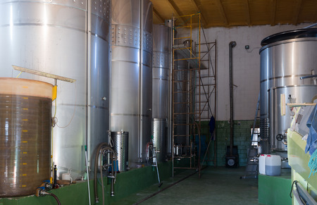 stell: Interior   of small contemporary  winery factory with  stell barrels