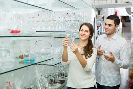 25 35: Young couple looking at glassware at shop Stock Photo