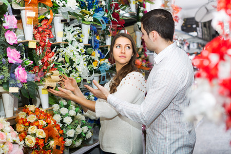 25 35: Happy couple in a flower shop Stock Photo