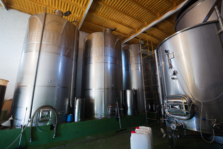stell: Small  contemporary winery with  stell barrels Stock Photo