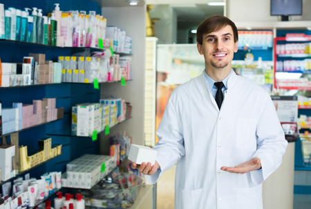 farmacy: Portrait of positive american male pharmacists working in modern farmacy Stock Photo