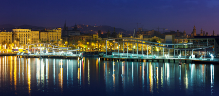 columb: Port Vell in summer night. Barcelona, Spain