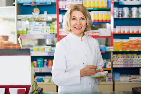 farmacy: Mature female pharmacists working in modern farmacy Stock Photo