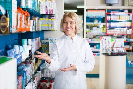 farmacy: Portrait of female pharmacists working in modern farmacy