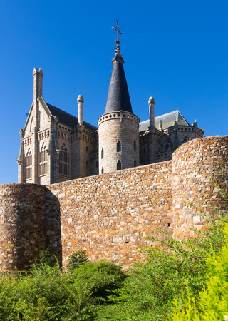 episcopal: Ancient town walls  and Episcopal Palace of Astorga in summer day.   Spain