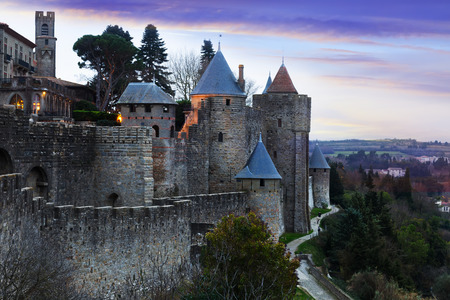 antiquary: Medieval  fortness walls in evening.  Carcassonne, France