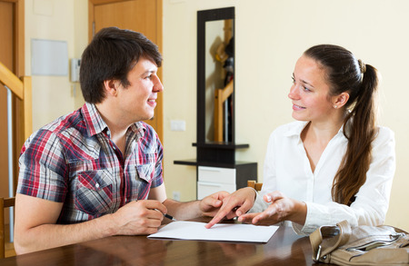 woman real estate agent signing agreement at home