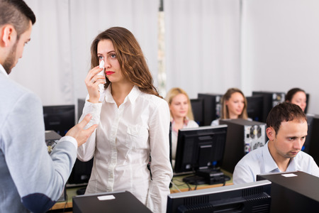 supervisor: Furious young supervisor scolding upset office worker