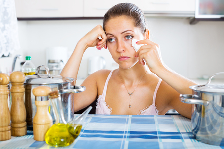 dispirited: Portrait of depressed adult woman feeling blue indoors