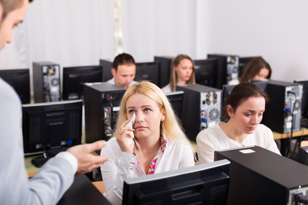 working area: Furious boss and young crying clerk at open space working area Stock Photo