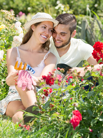 floriculturist: young russian family spends their summer vacation in the country