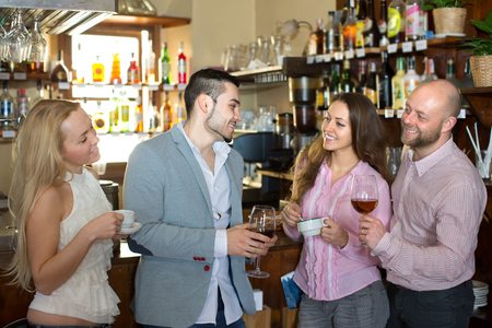 acquaintance: Casual acquaintance of happy young adults at bar. Selective focus Stock Photo