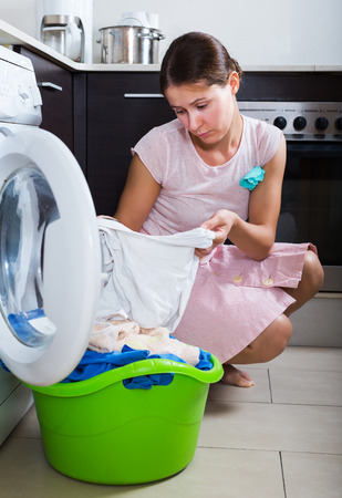 25 35: Upset woman cannot wash stains off white shirt