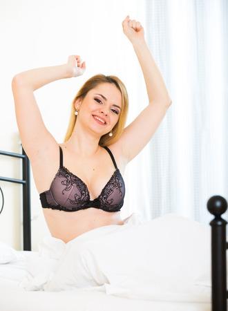 awaking: Portrait of blondie with fancy underwear awaking  in bed