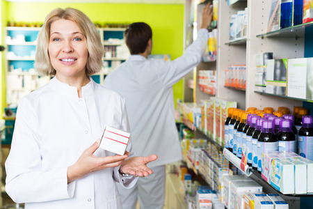 farmacy: Portrait of mature female pharmacists working in modern farmacy