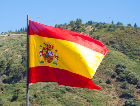 tricolour: Spanish tricolour fluttering on wind, mountains at the distance