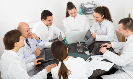 colloquium: Multinational interns and experienced professor cooperating at the hospital meeting Stock Photo