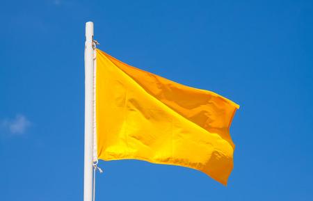 penalty flag: International maritime signal or racing yellow flag at blue sky Stock Photo