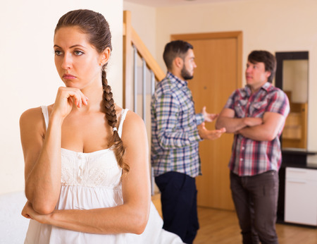 polygamy: Unhappy woman with  men having troubles at home