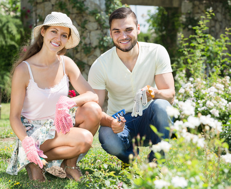 floriculturist: adult happy american family spends their summer vacation in the country