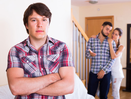 polygamy: Attractive young woman and two men: problems of love triangle