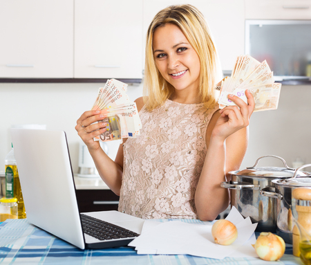 received: Satisfied female received interest on the deposits Stock Photo