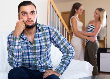 misunderstanding: Three young friends having misunderstanding at home