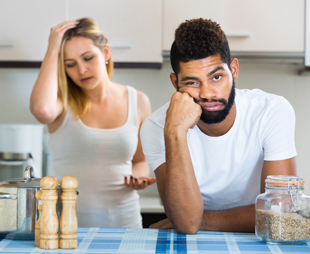 frustrated: Upset black man and frustrated young housewife having bad argument Stock Photo