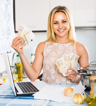 the deposits: Satisfied female received interest on deposits Stock Photo