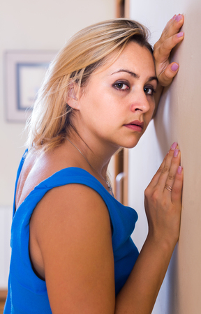 spanish home: sad spanish adult girl grieving for something at home