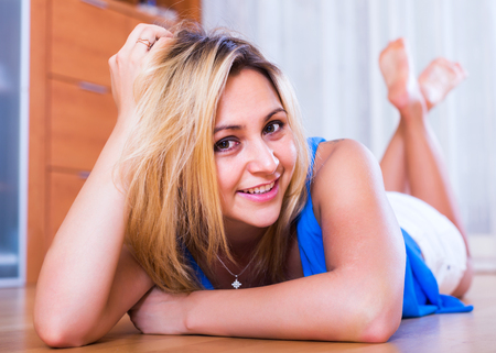 25s: Portrait of friendly happy girl in casual clothing at home interior