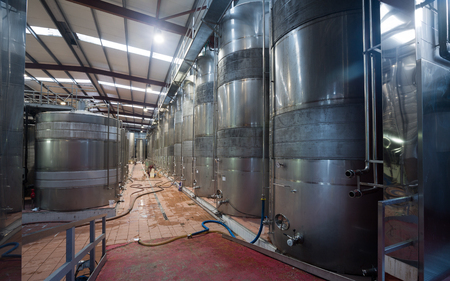 cava: contemporary  winery factory with  stell barrels Stock Photo