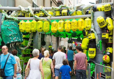 toxic waste: BARCELONA, SPAIN - AUGUST 16, 2015:  Gracia Festival  in Barcelona, Catalonia. Decorated streets of Gracia district. Theme of toxic waste