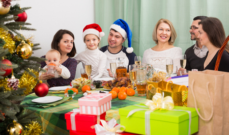 granny and grandad: All family together celebrating Christmas with mom dad and kids; Stock Photo