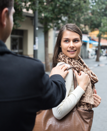 sidewalk talk: Charming young brunette flirting with guy at the street