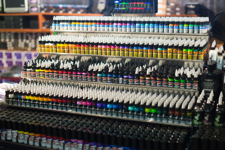 17th: BARCELONA, SPAIN - OCTOBER 3, 2014: Tubes of professional tattoo paint at showcase. The 17th edition of The Barcelona Tattoo Expo