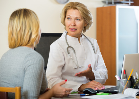 therapeutist: Blond patient and senior therapeutist at appointment in clinic