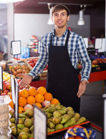 seasonal worker: Grocery worker selling seasonal fruits in farm food store